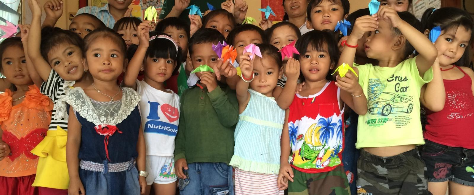 Projects Abroad volunteers pose with children on the Cambodia Childcare Project